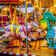 Carousel. Horses on a carnival Merry Go Round. — Stock Photo #23267084