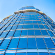 Modern blue glass wall of skyscraper — Stock Photo #23267272