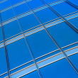 Modern blue glass wall of skyscraper — Stock Photo #23267384