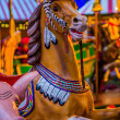 Carousel. Horses on carnival Merry Go Round. — Stock Photo #23267678