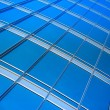 Modern blue glass wall of skyscraper — Stock Photo #23267690