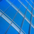 Modern blue glass wall of skyscraper — Stock Photo