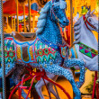 Carousel. Horses on a carnival Merry Go Round. — Stock Photo #23268130