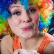 Woman in clown's wig smiling pulling fake hair on the sides — Stock Photo