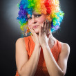Woman in clown's wig smiling pulling fake hair on the sides — Stock Photo #24399729