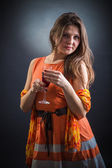 Woman with wine glass in hand — Stock Photo