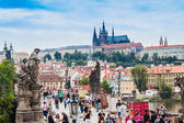 Karlov or charles bridge in Prague in summer — Stok fotoğraf