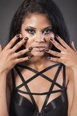 Beautiful woman is showing nails. Fashion portrait. — Stock Photo