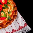 Ukrainian festive bakery Holiday Bread on black — Stock Photo #25750511