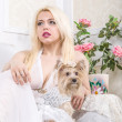 Luxurious blonde woman in a white dress with a dog pekingese — Stock Photo #26823533