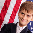 Portait of Caucasian boy with American flag — Stock Photo #29357589