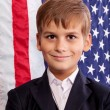 Portait of Caucasian boy with American flag — Stock Photo