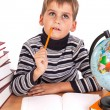 Cute schoolboy is thinking — Stock Photo