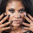 Beautiful woman is showing nails. Fashion portrait. Close-up fac — Stock Photo #30872223
