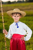Young cute boy fishing in a river — Stock Photo