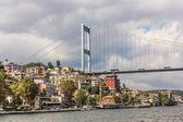 Ataturk Bridge is a first suspension bridge over the Bosphorus — Stock Photo