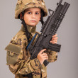 Stock Photo: Young boy dressed like a soldier with rifle