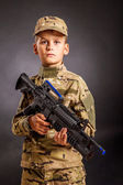 Young soldier with rifle — Stock Photo