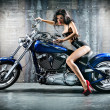 Woman sitting on motorcycle — Stock Photo #34696917