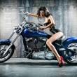 Woman sitting on motorcycle — Stok fotoğraf