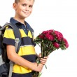 Schoolboy is holding flowers. Back to school — Stock Photo
