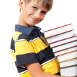 School boy is holding books — Stock Photo