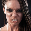 Portrait of an angry african american woman with dreadlocks — Stock Photo