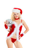 Sexy santa helper with big disco ball — Stock Photo