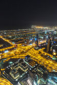 Dubai downtown night scene with city lights, — Stock Photo