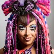 Portrait of a woman with multicolored dreadlocks and stylish mak — Stok fotoğraf