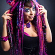 Portrait of a woman with multicolored dreadlocks and stylish mak — Stock Photo #36130243