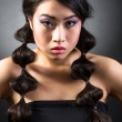 Beautiful brunette Asian woman with long black hair — Stock Photo #36311229