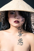 Beautiful brunette Asian woman wears vietnam hat — Stock Photo