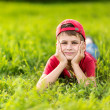 Stock Photo: Portrait of a happy little boy in the park