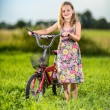 Young girl riding bicycle in a park — Stock Photo #36536227