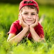 Portrait of a happy little boy in the park — Stockfoto