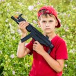Stock Photo: Boy holding gun in field.