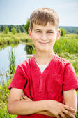 Closeup of cute young teen boy smiling — Stock Photo
