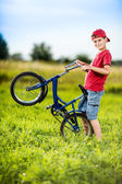 Young boy riding bicycle in a park — Stock Photo