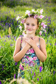Portrait of a little girl in wreath of flowers — Stock Photo