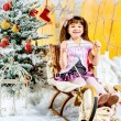 Stock Photo: Little girl with gifts under the Christmas tree