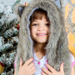 Cute little happy girl posing in a fur hat. — Stok fotoğraf