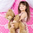 Little Girl Hugging Teddy Bear — Stock Photo