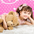 Stock Photo: Little Girl Hugging Teddy Bear