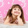 Little cute girl is on the fur carpet — Stock Photo