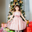 Stock Photo: Happy small girl have a christmas
