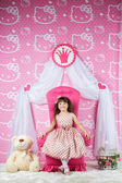Little princess on a pink throne — Stock Photo