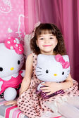 Cute little girl laying in bed — Stock Photo