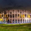 Stock Photo: Colosseum at night