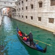 Gondolier on Grand Canal — Stock Photo #38901643